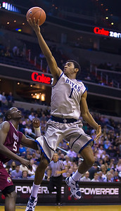Hoyas Hollis Thompson goes over Alex Young of IUPUI
