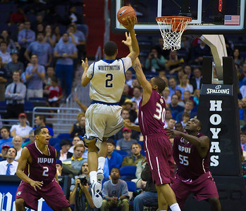 Hoyas' Greg Whittington shoots over IUPUI's Donovan Gibbs