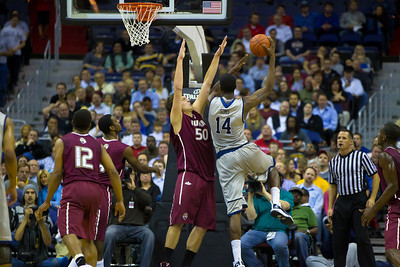 Hoyas' Henry Sims shoots over Jaguars' Mitchell Patton