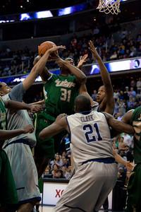 Jarrid Famous drives to basket, Jason Clark defending