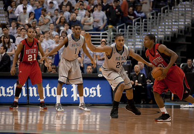 Mike Coburn guarded by Jerrelle Benimon