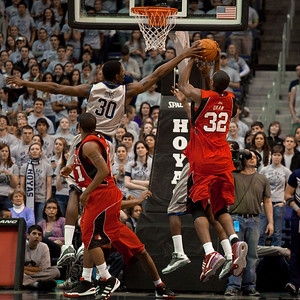 Henry Sims blocks the shot of Brian Okam