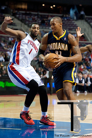 Dec 15, 2012; Auburn Hills, MI, USA; Indiana Pacers power forward David West (21) drives to the basket against Detroit Pistons center Andre Drummond (1) during the fourth quarter at The Palace. Pacers won 88-77. Mandatory Credit: Tim Fuller-USA TODAY Sports