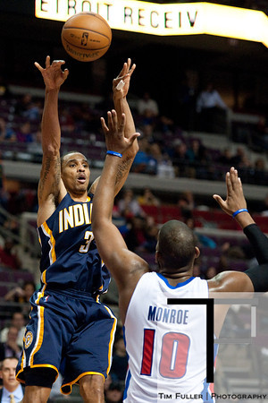 Dec 15, 2012; Auburn Hills, MI, USA; Indiana Pacers point guard George Hill (3) passes over Detroit Pistons center Greg Monroe (10) during the third quarter at The Palace. Pacers won 88-77. Mandatory Credit: Tim Fuller-USA TODAY Sports