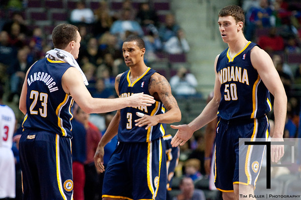 Dec 15, 2012; Auburn Hills, MI, USA; Indiana Pacers point guard Ben Hansbrough (23) high fives power forward Tyler Hansbrough (50) during the third quarter against the Detroit Pistons at The Palace. Pacers won 88-77. Mandatory Credit: Tim Fuller-USA TODAY Sports