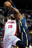 Dec 15, 2012; Auburn Hills, MI, USA; Detroit Pistons center Greg Monroe (10) goes to the basket against Indiana Pacers center Roy Hibbert (55) during the first quarter at The Palace. Mandatory Credit: Tim Fuller-USA TODAY Sports