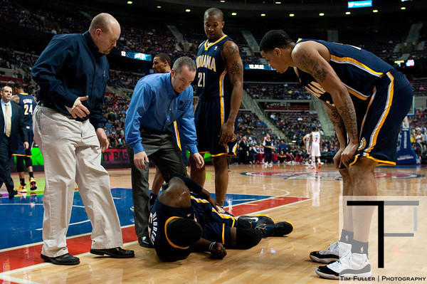 Dec 15, 2012; Auburn Hills, MI, USA; Indiana Pacers center Roy Hibbert (55) is looked over by team personal after being injured during the second quarter against the Detroit Pistons at The Palace. Mandatory Credit: Tim Fuller-USA TODAY Sports
