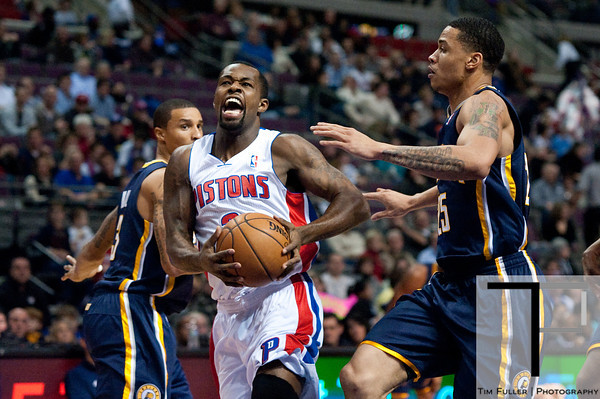 Dec 15, 2012; Auburn Hills, MI, USA; Detroit Pistons point guard Rodney Stuckey (3) gets past Indiana Pacers defenders during the first quarter at The Palace. Mandatory Credit: Tim Fuller-USA TODAY Sports