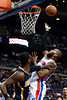 Dec 15, 2012; Auburn Hills, MI, USA; Detroit Pistons center Greg Monroe (10) lays it up during the second quarter against the Indiana Pacers at The Palace. Mandatory Credit: Tim Fuller-USA TODAY Sports