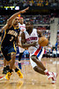 Feb 23, 2013; Auburn Hills, MI, USA; Detroit Pistons point guard Will Bynum (12) drives to the basket against Indiana Pacers point guard George Hill (3) during the second quarter at The Palace. Mandatory Credit: Tim Fuller-USA TODAY Sports