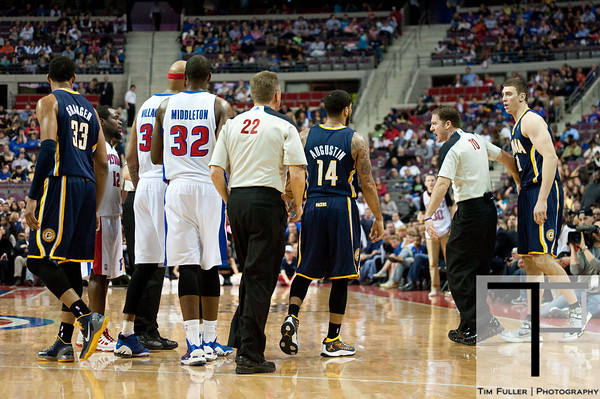 Feb 23, 2013; Auburn Hills, MI, USA; NBA referee Bill Spooner (22) and referee Brent Barnaky (70) separate Indiana Pacers and Detroit Pistons players after a scuffle during the fourth quarter at The Palace. Pacers win 90-72. Mandatory Credit: Tim Fuller-USA TODAY Sports