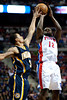 Feb 23, 2013; Auburn Hills, MI, USA; Detroit Pistons point guard Will Bynum (12) shoots over Indiana Pacers point guard George Hill (3) during the second quarter at The Palace. Mandatory Credit: Tim Fuller-USA TODAY Sports