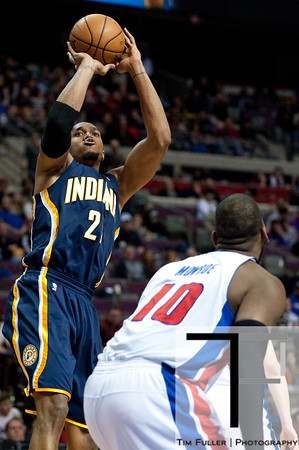 Feb 23, 2013; Auburn Hills, MI, USA; Indiana Pacers power forward David West (21) shoots over Detroit Pistons center Greg Monroe (10) during the third quarter at The Palace. Pacers win 90-72. Mandatory Credit: Tim Fuller-USA TODAY Sports