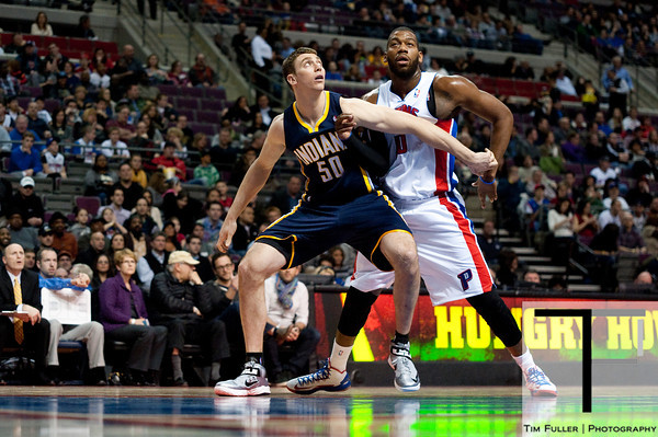 Feb 23, 2013; Auburn Hills, MI, USA; Indiana Pacers power forward Tyler Hansbrough (50) boxes out Detroit Pistons center Greg Monroe (10) during the first quarter at The Palace. Mandatory Credit: Tim Fuller-USA TODAY Sports