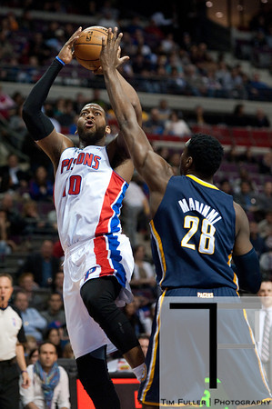 Feb 23, 2013; Auburn Hills, MI, USA; Detroit Pistons center Greg Monroe (10) shoots over Indiana Pacers center Ian Mahinmi (28) during the first quarter at The Palace. Mandatory Credit: Tim Fuller-USA TODAY Sports