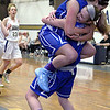 Leominster's Quinn O'Connell needed 18 points to reach 1,000 for her career an in the third quarter she got the last basket to make it 1001. After making the basket her teammate Arianna Bilotta jumped into her arms. SENTINEL & ENTERPRISE/JOHN LOVE
