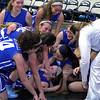Leominster's Quinn O'Connell needed 18 points to reach 1,000 for her career an in the third quarter she got the last basket to make it 1001. After she made that basket she was mobbed by her team. You can see her smiling at the bottom of the pile. SENTINEL & ENTERPRISE/JOHN LOVE