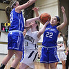 Leominster High School girls basketball played St. Bernard's on Tuesday night. St. B's player Jillian Pinard tries to get a shot off while covered by LHS's Gina Dedo and Kayla Brandes. SENTINEL & ENTERPRISE/JOHN LOVE
