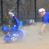 Leominster High School player Justin Robbins slides into second base, safe, as Auburn High School player Josh Tower tries to tag him on Thursday morning at Doyle Field. SENTINEL & ENTERPRISE/JOHN LOVE