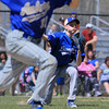 Leominster High School pitcher Alec Hanney picks up a ground ball in front of the mound and fires it to first trying to bet the Auburn High School player on Thursday morning at Doyle Field. SENTINEL & ENTERPRISE/JOHN LOVE