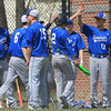 Leominster High School player Rocco Pandiscio (#2) gets congratulated by teammates after scoring a run during action against Auburn High School on Thursday morning at Doyle Field. SENTINEL & ENTERPRISE/JOHN LOVE