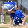 Leominster High School player Brandon Lefebve dives back to first during action against Auburn High School on Thursday morning at Doyle Field. SENTINEL & ENTERPRISE/JOHN LOVE