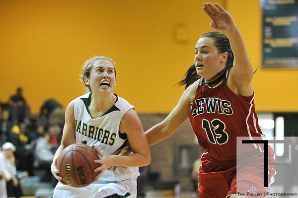 Nov 17, 2012; Detroit, MI, USA; Wayne State Warriors guard Kristen Long (11) and Lewis Flyers guard Nikki Nellen (13) during the game at the Matthaei Center. Credit: Tim Fuller-Wayne State Athletics