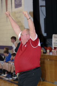 Leyton head coach Gary Oltmann celebrates after his Leyton Warriors had just won the District Championship aginst Arthur County on Tuesday in Garden County.