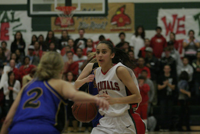 Megan Salinas of Lindsay brings the ball up court against Exeter's Jacqueline Hutchenson on February 26, 2013.