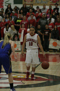 Lindsay Cardinal guard Christina Castro against Exeter's Amber Atkinson (1) on February 26, 2013.
