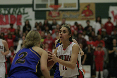 Linsday's Megan Salinas (11) prepares to shoot against Exeter's Jacqueline Hutchenson (2) on February 26, 2013.