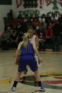 Christina Castro dribbles and Amber Atkinson on February 26, 2013.