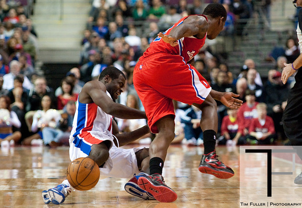 Dec 17, 2012; Auburn Hills, MI, USA; Los Angeles Clippers point guard Eric Bledsoe (right) collides with Detroit Pistons point guard Will Bynum (12) during the fourth quarter at The Palace. Clippers won 88-76. Mandatory Credit: Tim Fuller-USA TODAY Sports