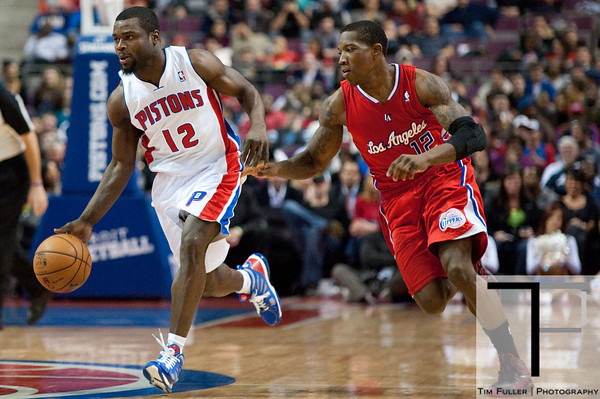 Dec 17, 2012; Auburn Hills, MI, USA; Detroit Pistons point guard Will Bynum (12) brings the ball up court against Los Angeles Clippers point guard Eric Bledsoe (12) during the fourth quarter at The Palace. Clippers won 88-76. Mandatory Credit: Tim Fuller-USA TODAY Sports