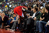 Dec 17, 2012; Auburn Hills, MI, USA; Los Angeles Clippers center Ronny Turiaf (21) crashes in to fans during the fourth quarter against the Detroit Pistons at The Palace. Clippers won 88-76. Mandatory Credit: Tim Fuller-USA TODAY Sports