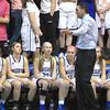 Emma Houston daughter of Deb Houston with her teammates listen to Coach Frank Greene