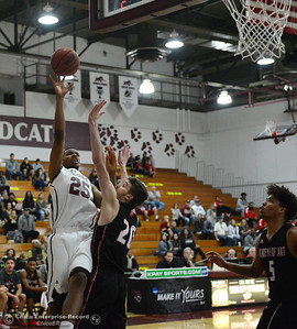 Chico State center Justin Briggs sinks a shot against Ivan Furlan (20) and Kendall Brown (5) as the Wildcats play Academy of Art during the 57th annual Mac Martin Classic basketball tournament Friday, nov. 25, 2016, at Acker Gym in Chico, California. (Dan Reidel -- Enterprise-Record)