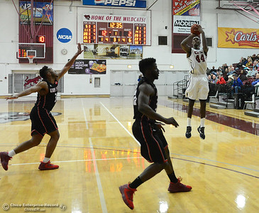 Isaiah Ellis (44) sinks a 3-point shot as Chico State plays Academy of Art during the 57th annual Mac Martin Classic basketball tournament Friday, nov. 25, 2016, at Acker Gym in Chico, California. (Dan Reidel -- Enterprise-Record)