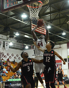 Isaiah Ellis scores against Academy of Art's Uchenna Okeneme (3) and Chance Maxwell as Chico State plays Academy of Art during the 57th annual Mac Martin Classic basketball tournament Friday, nov. 25, 2016, at Acker Gym in Chico, California. (Dan Reidel -- Enterprise-Record)