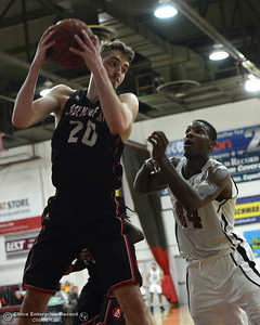 Academy of Art's Ivan Furlan (20) grabs a rebound in front of Chico State forward Isaiah Ellis (44) during the 57th annual Mac Martin Classic basketball tournament Friday, nov. 25, 2016, at Acker Gym in Chico, California. (Dan Reidel -- Enterprise-Record)