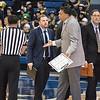 Coach Reggie Theus and a ref