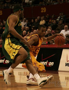 USC men's basketball vs. Oregon, 2.24.06 in the Sports Arena. USC lost 61-73.  LOS ANGELES (AP) - Malik Hairston scored 16 of his 18 points in the final 12 minutes to help lead Oregon to a 73-61 victory over USC on Thursday night.  The Ducks' Aaron Brooks led all scorers with 20 and Ray Schaefer had 13 as Oregon (13-15, 6-9 Pac-10) defeated the Trojans for the seventh time in eight meetings.  Ryan Francis scored 18 points for USC (16-10, 7-8). Trojans scoring leader Nick Young finished with 14.  Gabe Pruitt, who scored 30 points in an 84-78 win over Oregon at Eugene on Jan. 28, missed his fourth straight game because of a fracture in his left knee.  Oregon, coming off a 67-37 blowout of Washington State on Saturday in the Ducks' final home game of the year, could get a first-round bye in next month's Pacific 10 tournament by finishing sixth or better in the conference. The Ducks are currently seventh, a half game behind USC.