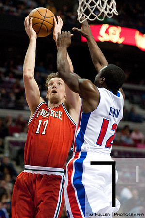 Dec 30, 2012; Auburn Hills, MI, USA; Detroit Pistons point guard Will Bynum (12) attempts to block Milwaukee Bucks small forward Mike Dunleavy (17) during the second quarter at The Palace. Mandatory Credit: Tim Fuller-USA TODAY Sports