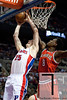 Dec 30, 2012; Auburn Hills, MI, USA; Milwaukee Bucks center Larry Sanders (8) attempts to block Detroit Pistons small forward Kyle Singler (25) during the fourth quarter at The Palace. Pistons won 96-94. Mandatory Credit: Tim Fuller-USA TODAY Sports