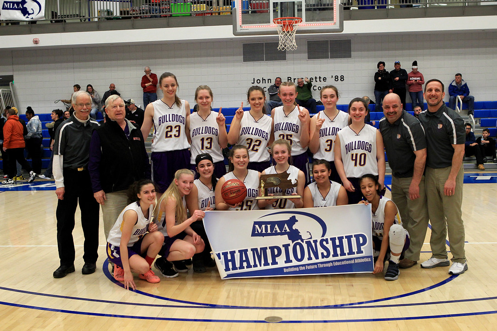 . The Monty Tech girls\' basketball team poses with its trophy after defeating Maynard, 56-49, to win the Central Mass. Division 4 title at Worcester State University on Saturday, March 9, 2019. SENTINEL & ENTERPRISE / VINCENT APOLLONIO
