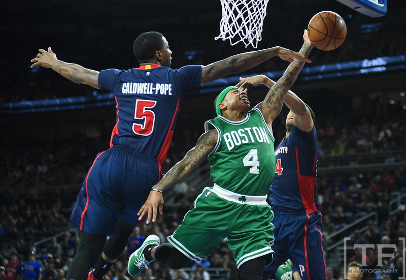 Feb 26, 2017; Auburn Hills, MI, USA; Boston Celtics guard Isaiah Thomas (4) goes to the basket as Detroit Pistons guard Kentavious Caldwell-Pope (5) defends during the fourth quarter at The Palace of Auburn Hills. Mandatory Credit: Tim Fuller-USA TODAY Sports