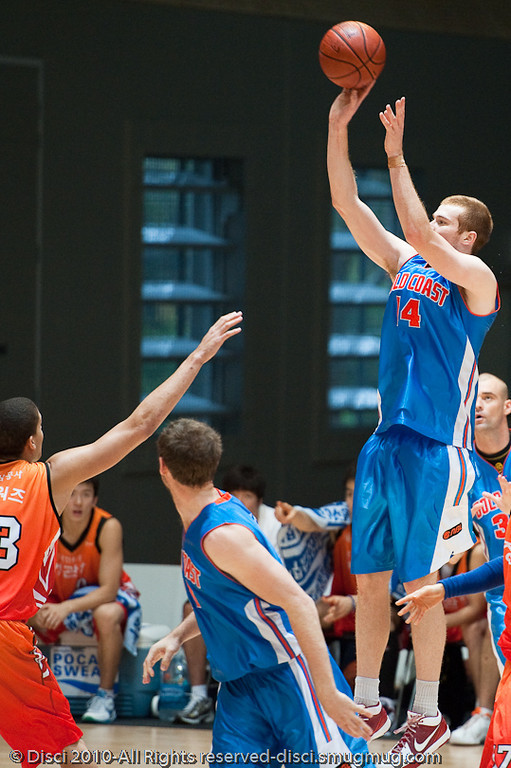 Tom Garlepp elevates - Pre-Season NBL International Basketball: Gold Coast Blaze v Anyang KT & G Kites - Korea; Logan City, Queensland, Australia; 2010.