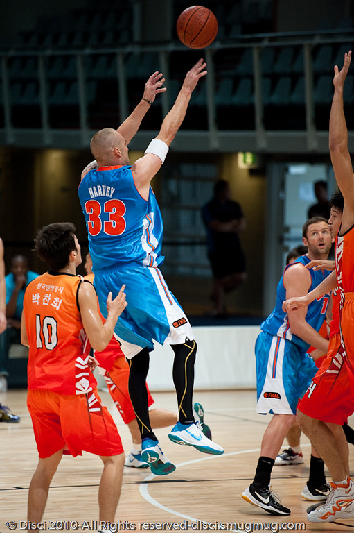 James Harvey lets one fly - Pre-Season NBL International Basketball: Gold Coast Blaze v Anyang KT & G Kites - Korea; Logan City, Queensland, Australia; 2010.