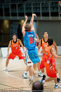 Shaun Gleeson shows copy-book shooting style - Pre-Season NBL International Basketball: Gold Coast Blaze v Anyang KT & G Kites - Korea; Logan City, Queensland, Australia; 2010.