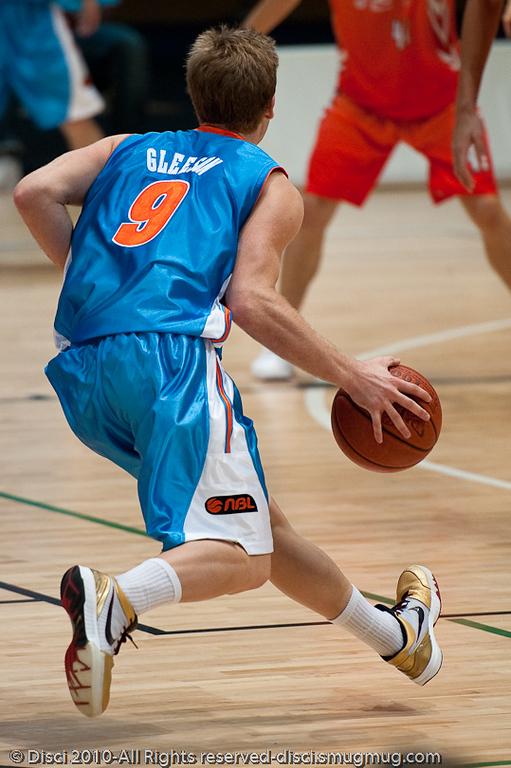 Magician Shaun Gleeson appears to levitate. Pre-Season NBL International Basketball: Gold Coast Blaze v Anyang KT & G Kites - Korea; Logan City, Queensland, Australia; 2010.